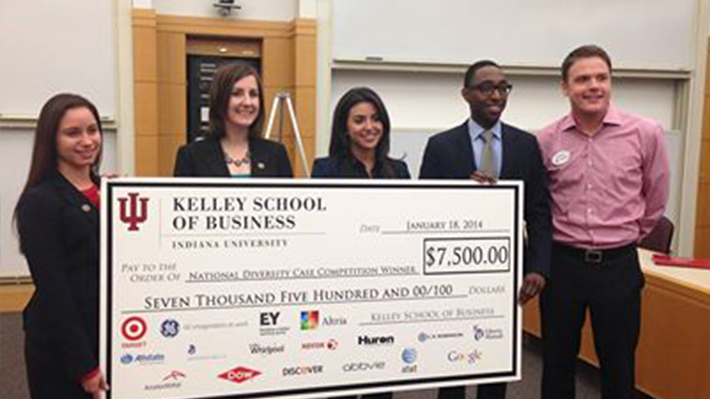 students with large check