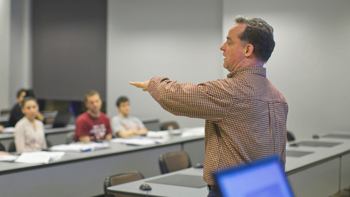 Finance instructor addresses students