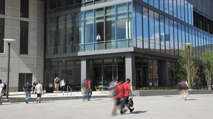 Students walk in front Gerri C. LeBow Hall
