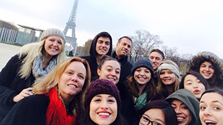 Students posing in front of Eiffel Tower during international residency trip