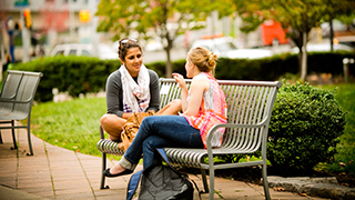 Women sitting and talking on the University City Campus