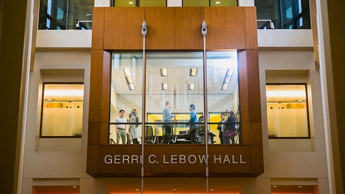 Group meet in Atrium conference room in Gerri C. LeBow Hall