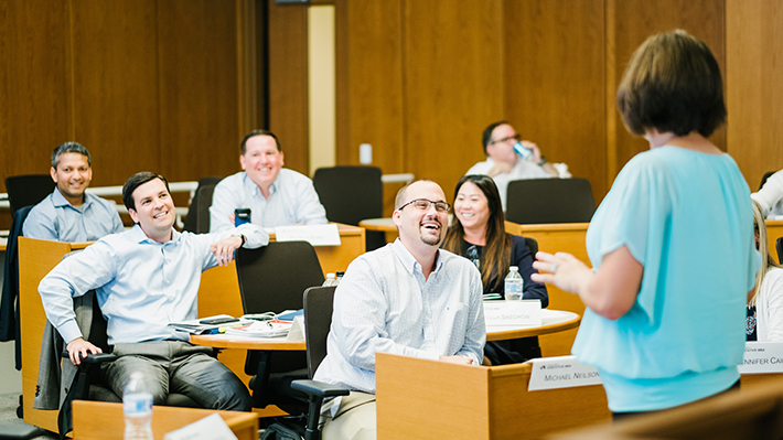 Executive MBA Students work together in classroom