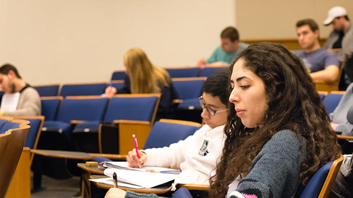 Graduate students study in lecture hall