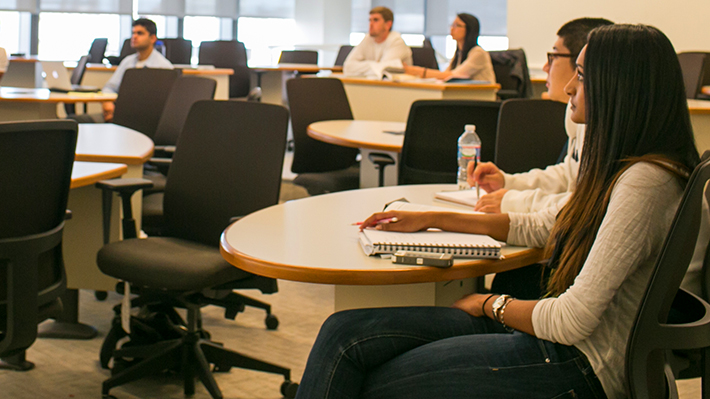 Prospective graduate students listens attentively