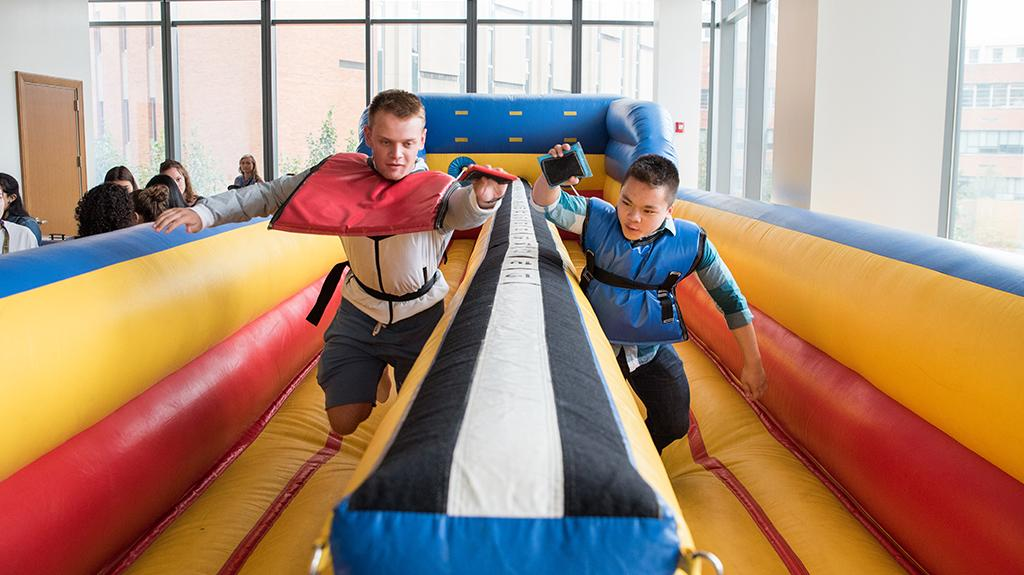 2 LeBow Freshmen racing on inflatable track