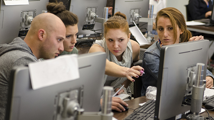 Students working together at a computer