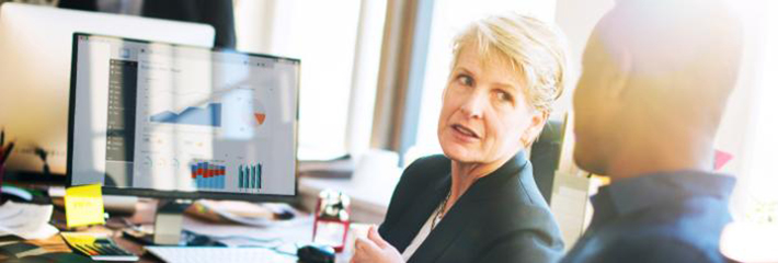 Executive Woman Collaborates in Office