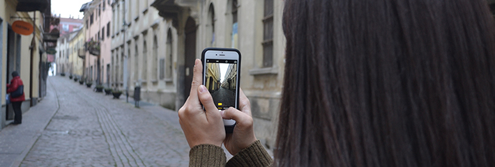 Student taking a photo on an international residency trip