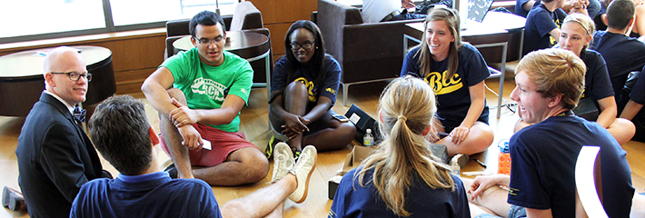 Students and faculty talking during welcome week