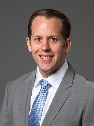 Headshot of Matthew Schneider