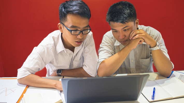 Two students working on a project