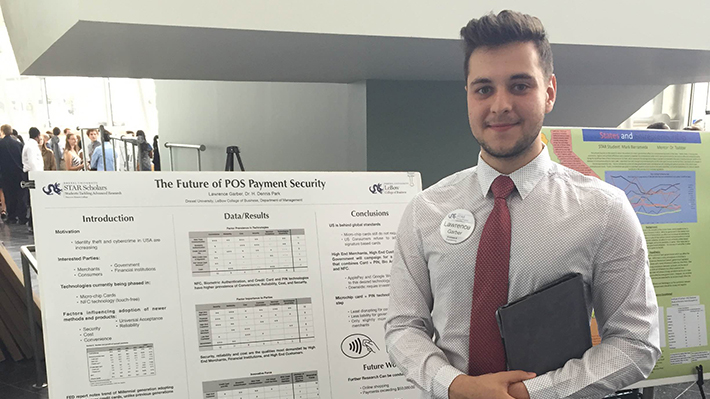 Student in front of presentation