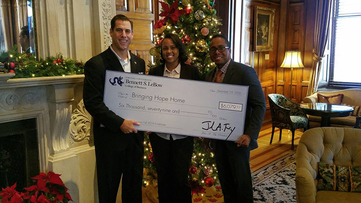 lebow presents check to bringing hope home