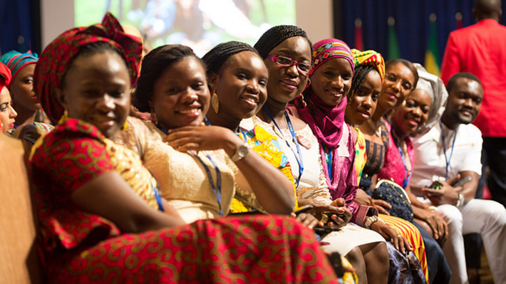 Young African Mandela Fellows Sitting in an Auditorium