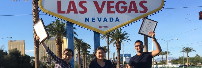 Arjun Arora, Hong Li and Ran Zhang in front of Las Vegas sign
