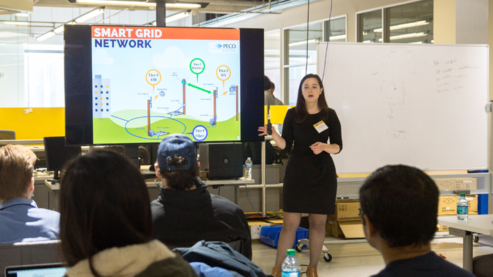 Woman presents PECO Internet of Things Technology to students