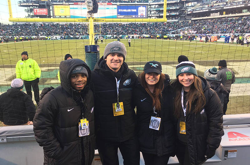 Students pose in the stadium at Eagles Super Bowl Game