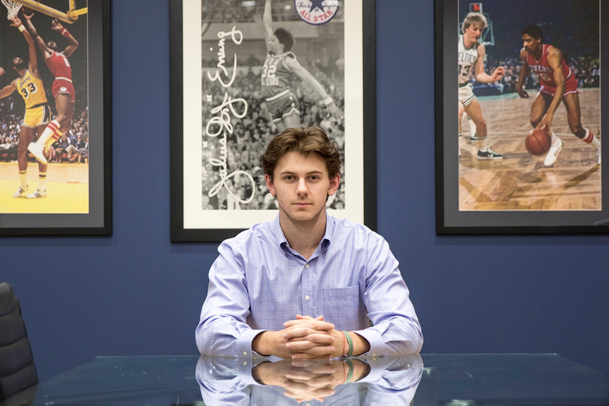 Alex Norcross poses in 76ers Office