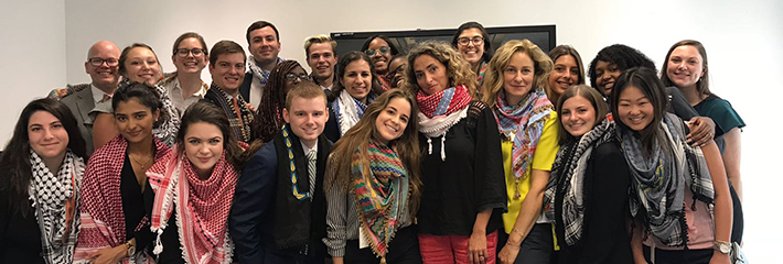 Geneva and London International Residency students pose with handmade scarves