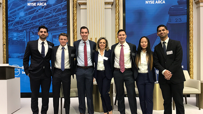NYSE students pose after presentation