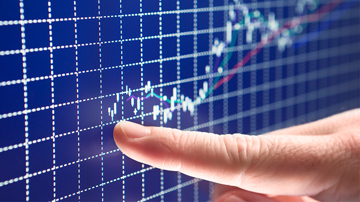 Finger following rising stock price on screen