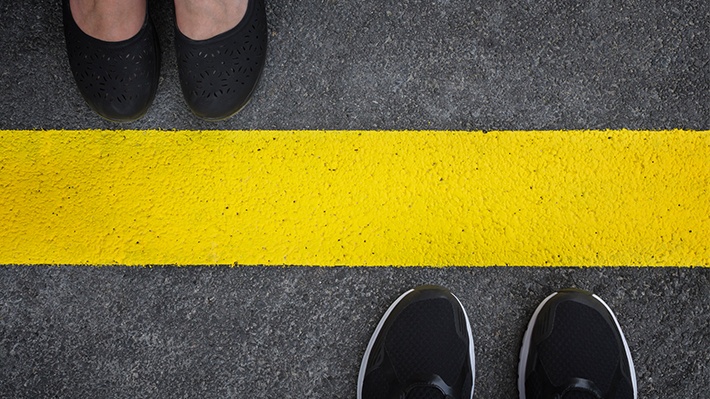 People divided by yellow line